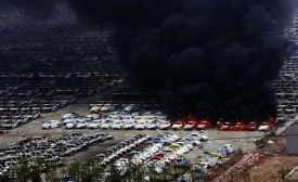 Cars burn in Tianjin after the explosion