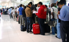 Travelers to Bangkok wait on line for visas