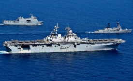 South China Sea: USS Wasp (LHD 1) maneuvers with Philippine Navy ships.