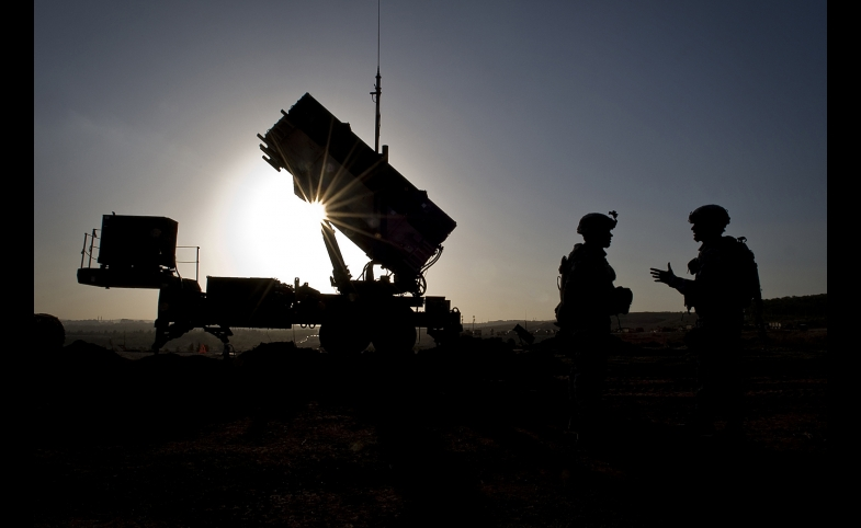 U.S. Soldiers with the 3rd Battalion, 2nd Air Defense Artillery Regiment talk after a routine inspection of a Patriot missile battery at a Turkish military base in Gaziantep, Turkey. U.S. and NATO Patriot missile batteries and personnel deployed to Turkey in support of NATO's commitment to defending Turkey's security during a period of regional instability.