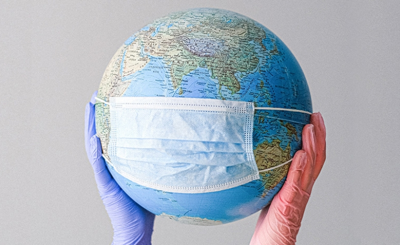 Globe with mask image by Anna Shvets via Pexels.com
