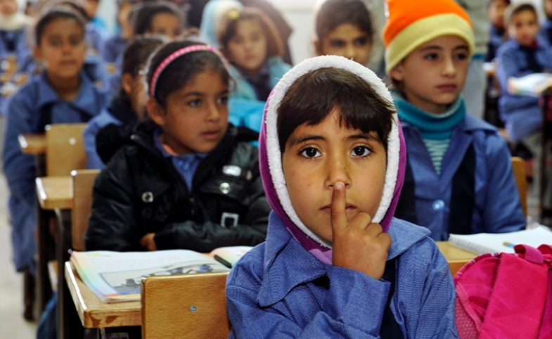 Photo: Children inside a classroom at Za'atri refugee camp, host to tens of thousands of Syrians displaced by conflict, near Mafraq, Jordan by United Nations Photo/Mark Garten via Flickr.
