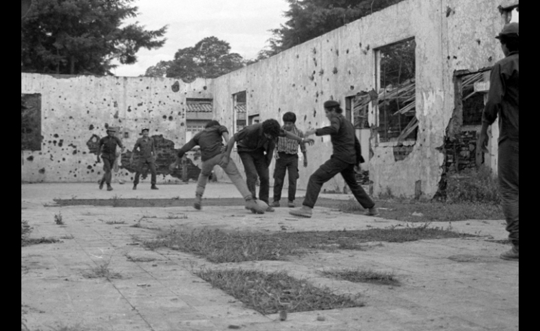 Guerrilla fighters playing soccer in El Salvador, late 1980s