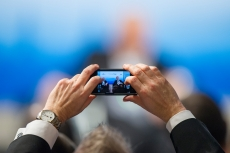 An audience member takes a photo at the 50th Munich Security Conference 2014: Diplomacy in a Digital Age: Diplomacy in a Digital Age