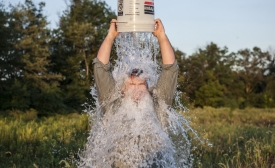 A man accepts the ALS Ice Bucket Challenge