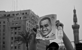 A protestor in Tahrir Square, Cairo, holds up a portrait of former President Nasir, 2011