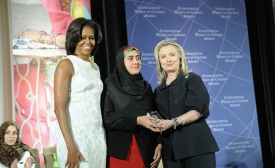 Secretary Clinton and First Lady Obama IWOC  by U.S. Department of State