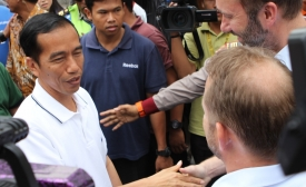 President Joko Widodo shakes hands during the election.