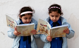 Young girls reading