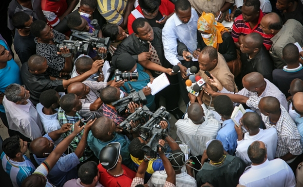 Police Commissioner Suleiman Kova answers and addresses the media at ground zero near the 2013 Dar es Salaam building collapse