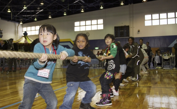 Students play at the U.S.-Japan Friendship Exchange at the Marine Corps Air Station in Iwakuni, Japan