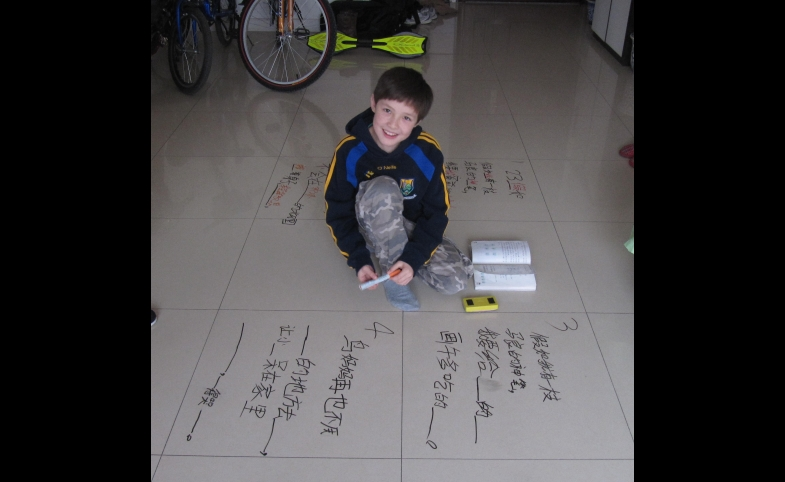 A young student learns Chinese.