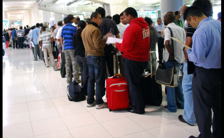 Travelers to Bangkok wait on line for visas