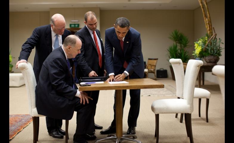 Ben Rhodes stands next to President Barack Obama